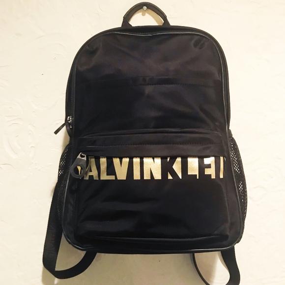 cefa4014ab Calvin Klein Handbags - Calvin Klein Black and Gold Logo Nylon Backpack